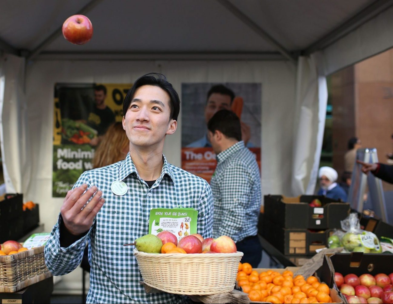 Woolworths-staff-throwing-apple-1-scaled-e1606425477812